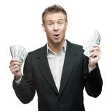 Young surprised businessman holding money Stock Photo