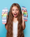 Young surprised girl with flip flops Stock Photography