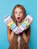 Young surprised girl with flip flops Royalty Free Stock Images