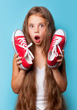 Young surprised girl with red gumshoes Stock Images