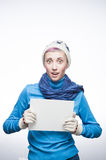 Young surprised girl with sign on gray background. Studio portrait of young attractive caucasian girl in winter clothing with surprised expression on gradient royalty free stock photo