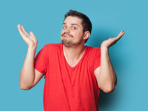 Young surprised guy in t-shirt Royalty Free Stock Photo
