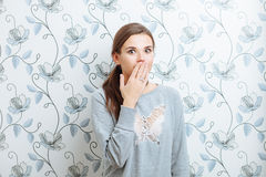 Young surprised hipster woman covers his mouth with his hand Stock Images