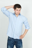 Young surprised man in blue jeans and shirt Stock Image