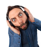 Young surprised man with headphones Stock Images