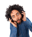 Young surprised man with headphones Royalty Free Stock Images
