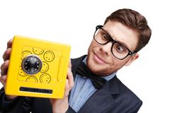 Young surprised man looking at little safe Stock Image