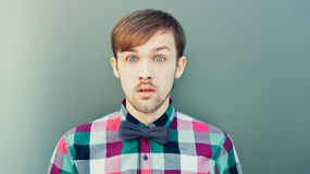 Young surprised man in shirt with bowtie Stock Photo