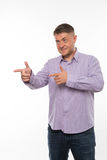 Young surprised man showing by hands. Stock Photo