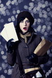 Young surprised postman girl with mail. Royalty Free Stock Photos