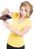Young surprised, unhappy, puzzled woman, girl holding an empty wallet Royalty Free Stock Image