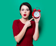 Young surprised woman with alarm clock Royalty Free Stock Image