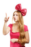 Young surprised woman with big pink bow Royalty Free Stock Photo