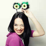 Young surprised woman with funny green eyes. Royalty Free Stock Photos