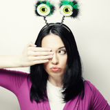Young surprised woman with funny green eyes. Stock Photos