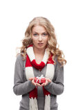 Young surprised woman holding christmas gift Royalty Free Stock Photos