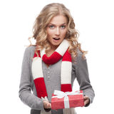 Young surprised woman holding christmas gift Stock Images