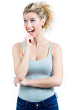 Young surprised woman holding her face Royalty Free Stock Image