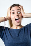 Young surprised woman holding her face Stock Image