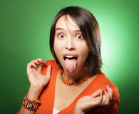 Young surprised woman over green background Stock Images