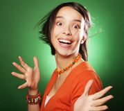 Young surprised woman over green background Royalty Free Stock Image