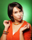 Young surprised woman over green background Royalty Free Stock Photo