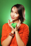 Young surprised woman over green background Stock Photos