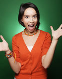 Young surprised woman over green background Royalty Free Stock Images