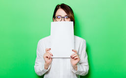 Young surprised woman with paper Stock Photos