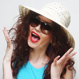 Young surprised woman wearing hat and sunglasses Royalty Free Stock Photo