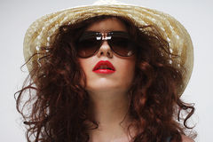 Young surprised woman wearing hat and sunglasses Stock Photography
