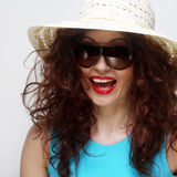 Young surprised woman wearing hat and sunglasses Stock Photo