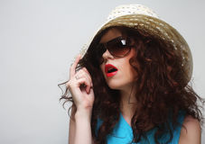 Young surprised woman wearing hat and sunglasses Stock Photos