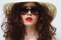 Young surprised woman wearing hat and sunglasses Royalty Free Stock Image