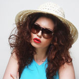 Young surprised woman wearing hat and sunglasses Stock Image
