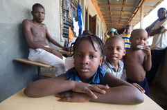 Young Survivors at a Church. September 27, 2008 - Children displaced by Hurricane Ike gather with their families in a church compound in Gonaives, Haiti after Stock Photos