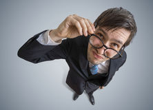 Young suspicious man is looking at you. View from top Stock Images