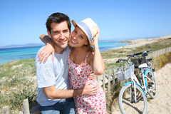 Young sweet couple enjoying holidays. Portrait of sweet couple spending vacation on island Stock Images