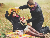 Young sweet couple having date in autumn park. Stock Photography