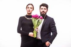 Young sweet couple with lila tulips stock image