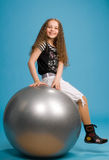 Young Sweet Girl On A Big Grey Ball Stock Photography