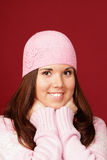 Young sweet girl in pink winter cloths Stock Photo