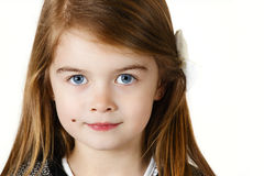 Young sweet girl. Six years old girl posing in the studio Royalty Free Stock Image