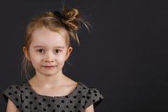 Young sweet girl. Six years old girl posing in the studio Stock Photo