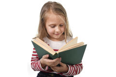Young sweet little 6 or 7 years old with blond hair girl reading Stock Image