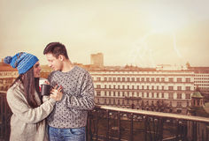 Young sweet romantic couple drinking coffee standing on terrace stock photo