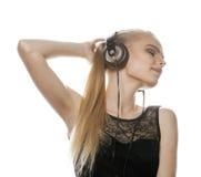 Young sweet talented teenage girl in headphones Stock Photo