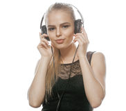 Young sweet talented teenage girl in headphones Royalty Free Stock Images