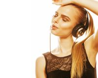 Young sweet talented teenage girl in headphones singing isolated. On white background Stock Image