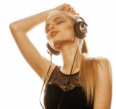 Young sweet talented teenage girl in headphones singing isolated on white Royalty Free Stock Images